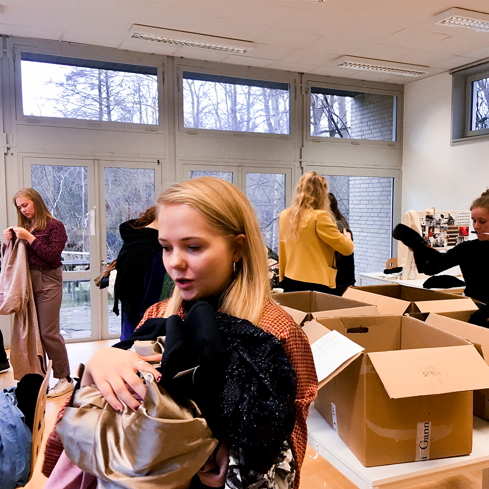 Fashion students in Copenhagen pack the donated clothing for the Fashion Fundraiser event in South Africa