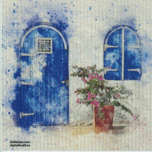 Disktrasa med motiv av blå dörr målad Kjell Mari Ekvall
