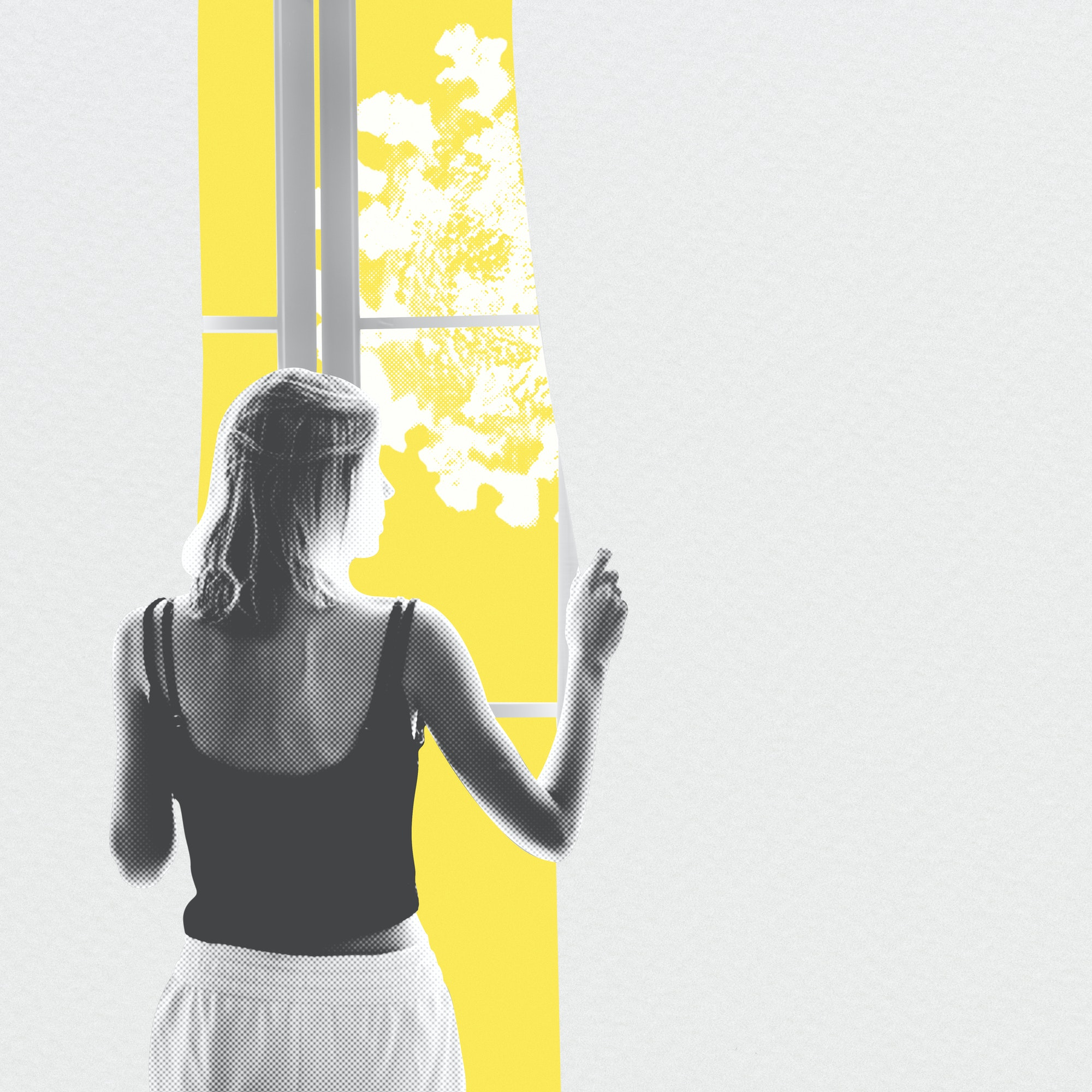 Young woman looking out of the window during coronavirus quarantine