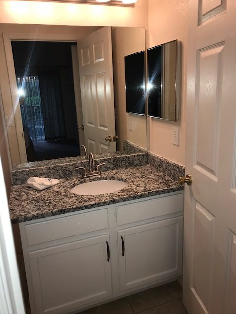 Master bathroom with new granite counter, undermount sink, new faucet, new cabinet