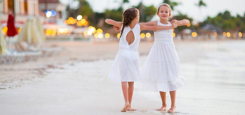 Kids having fun at tropical beach dancing and having fun