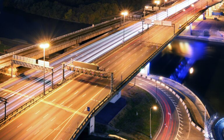 Road bridge across the river at night, view from above