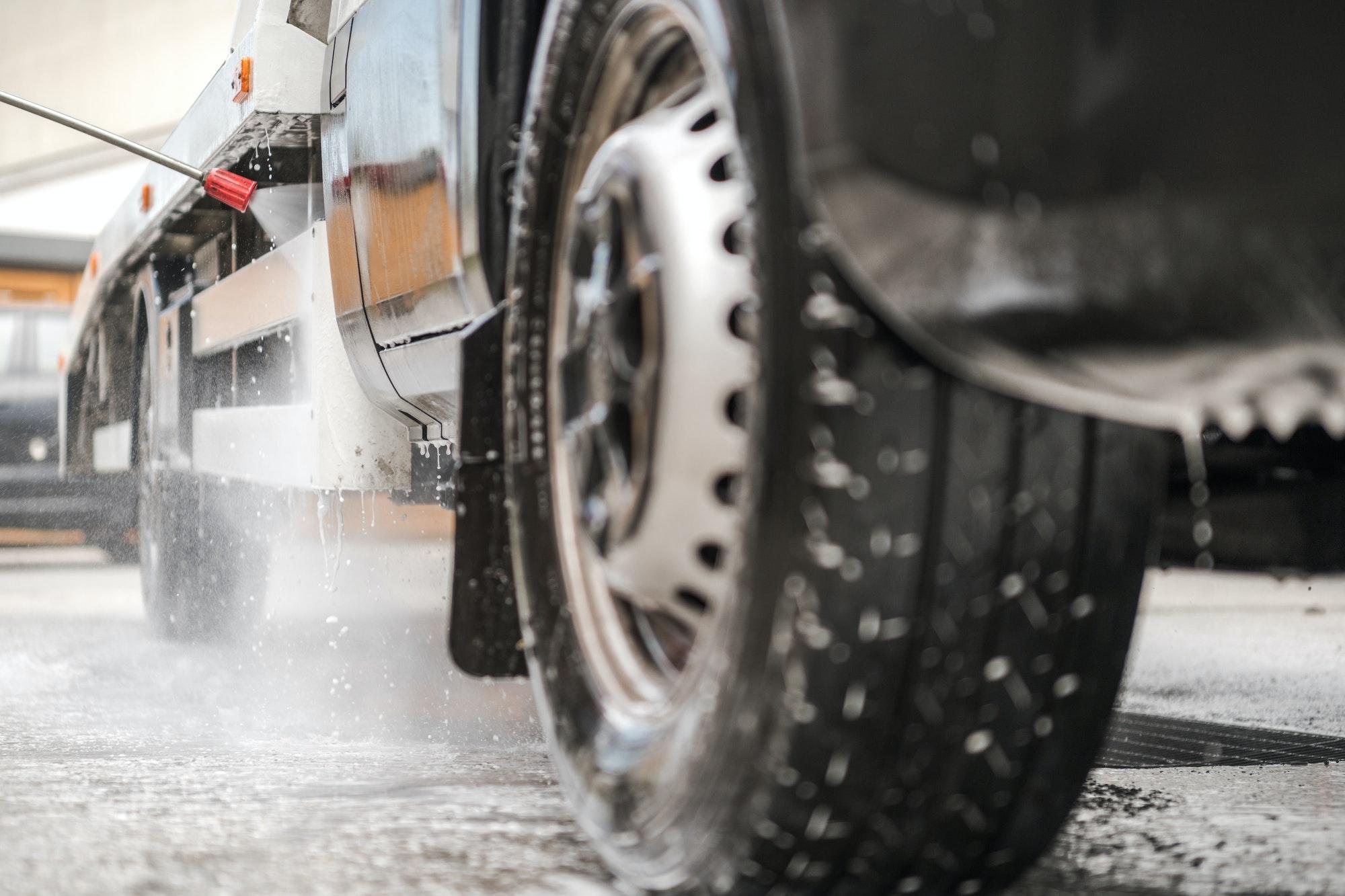 Manual Pressure Washing Truck In Car Wash.