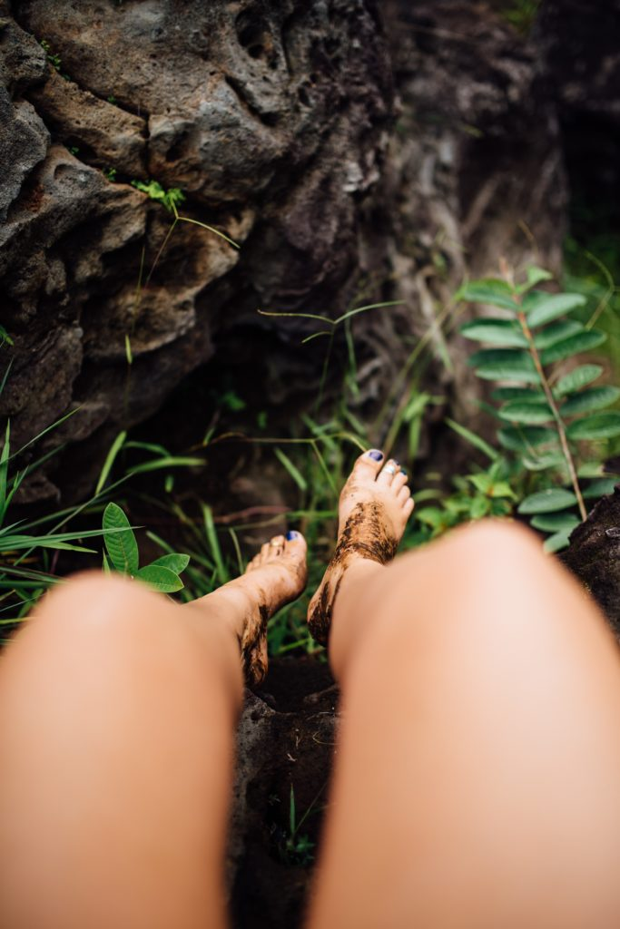 Bare feet with Earth on them.