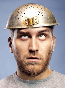 portrait of a man with a colander on his head