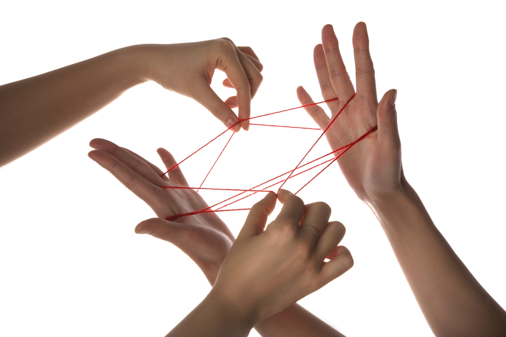 People playing cats cradle game,close-up