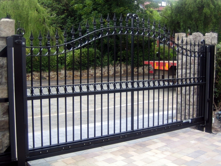 Sliding gate designed to look like two swing gates