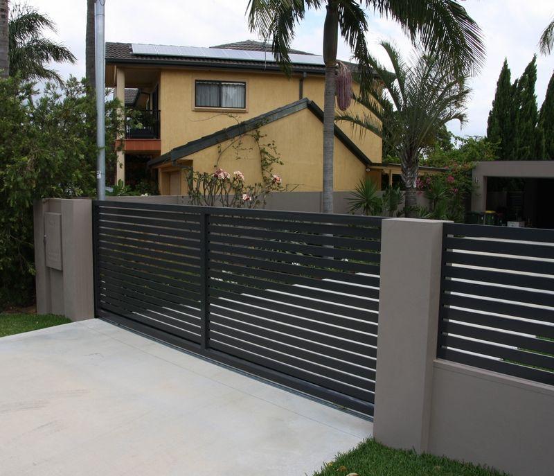 Black open boarded sliding gate