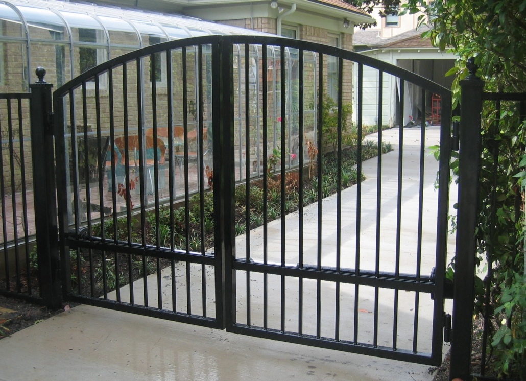 Curved top iron swing gates