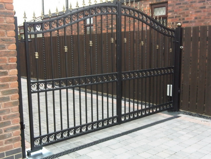 Ornate iron gates with a mid-rail