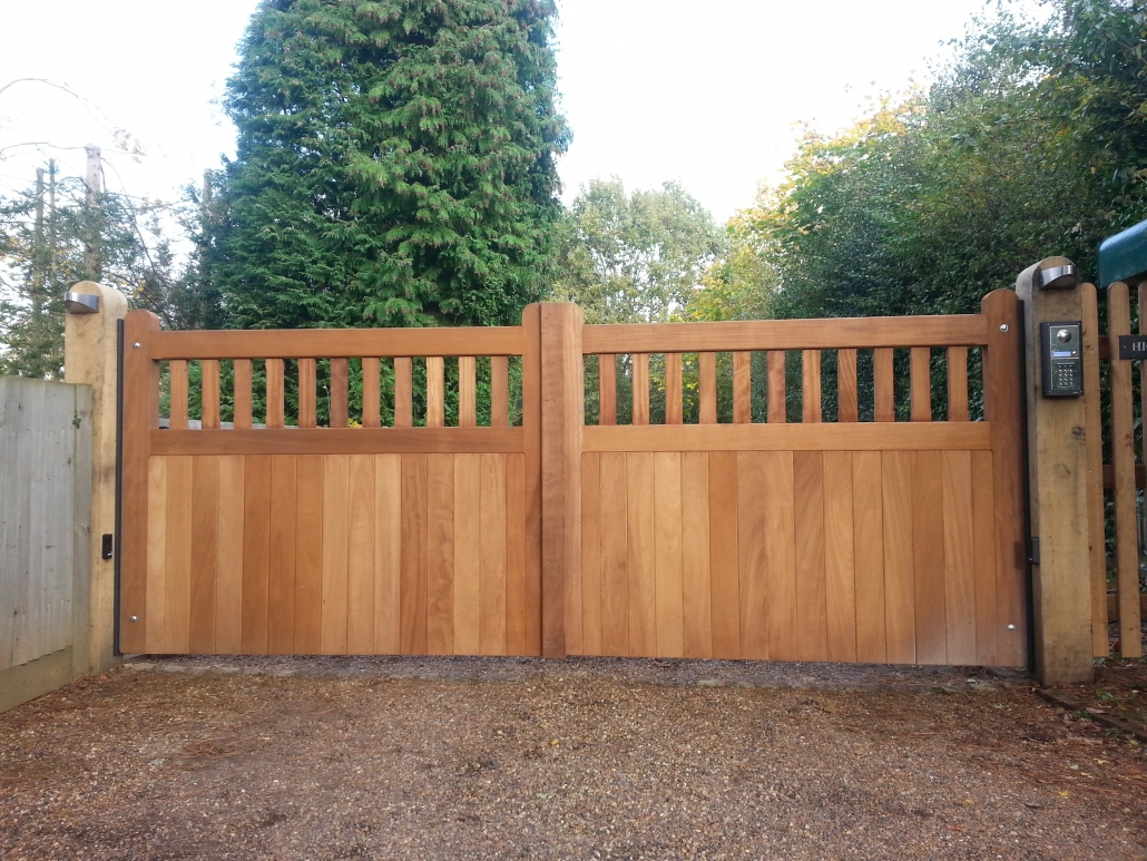 Wooden gates with part open boarded design