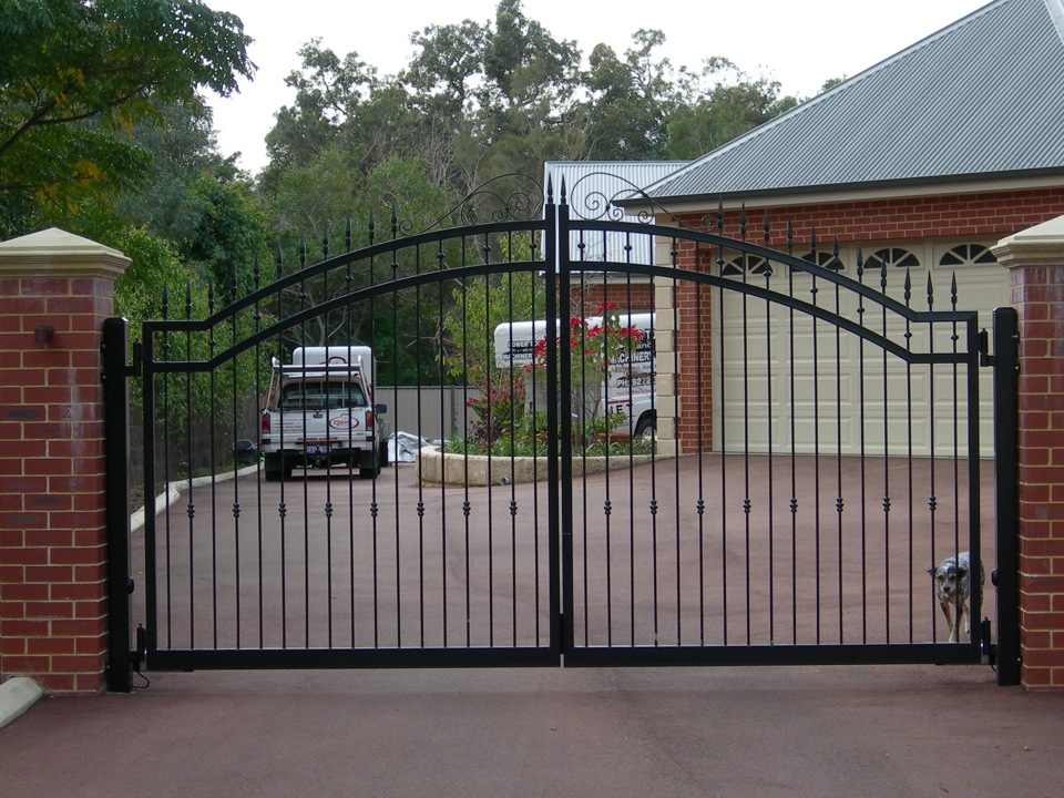 Curved top ornate swing gates in iron