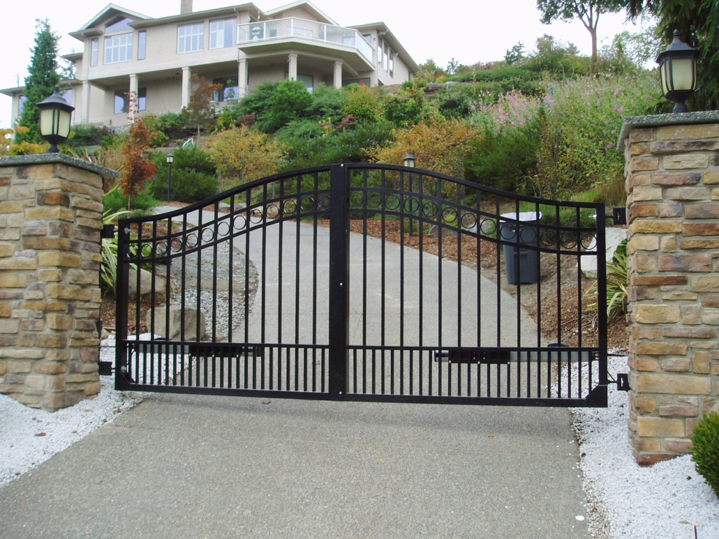 Curved top black swing gates