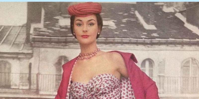 la modella anne gunning con un abito da cocktail sul numero di aprile 1953 di vogue