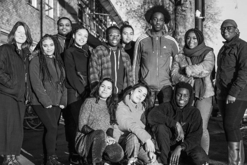 Black and white photograph of Rising Arts Agency's group of young creatives