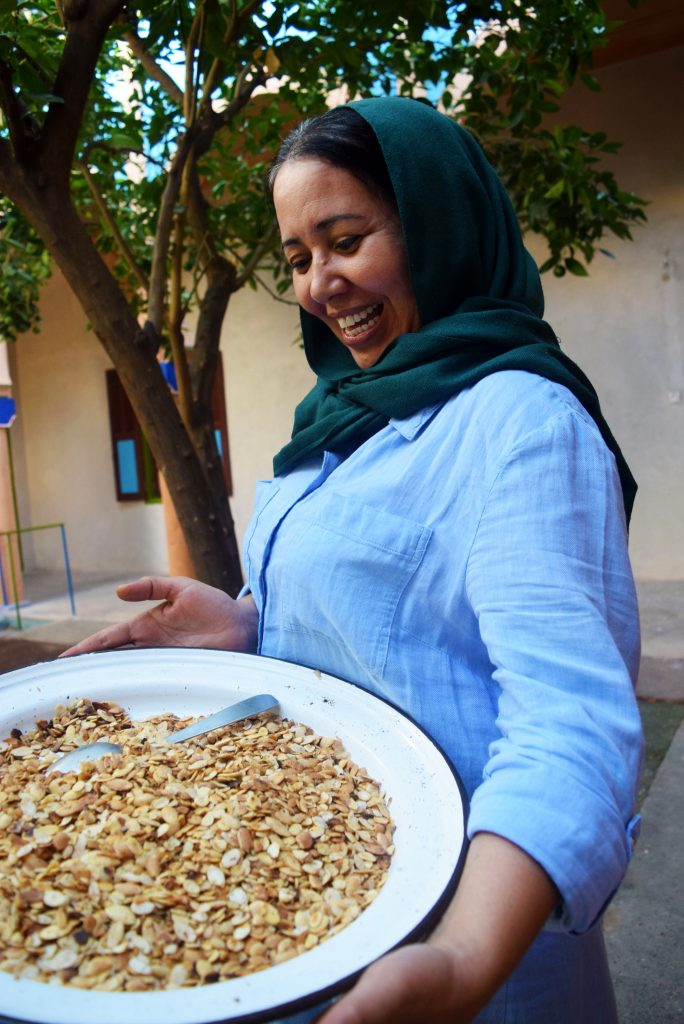 EBM - women holding roasted argan kernels