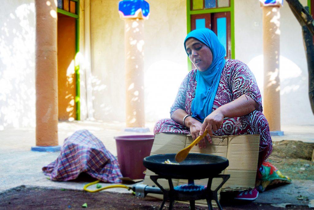 EBM - woman roasting argan kernel