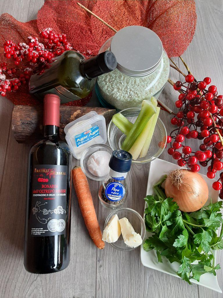 Foto degli ingredienti del risotto con riduzione e geleè di vino Bonarda che valorizza i prodotti tipici della Lombardia. Messaggio Promozionale