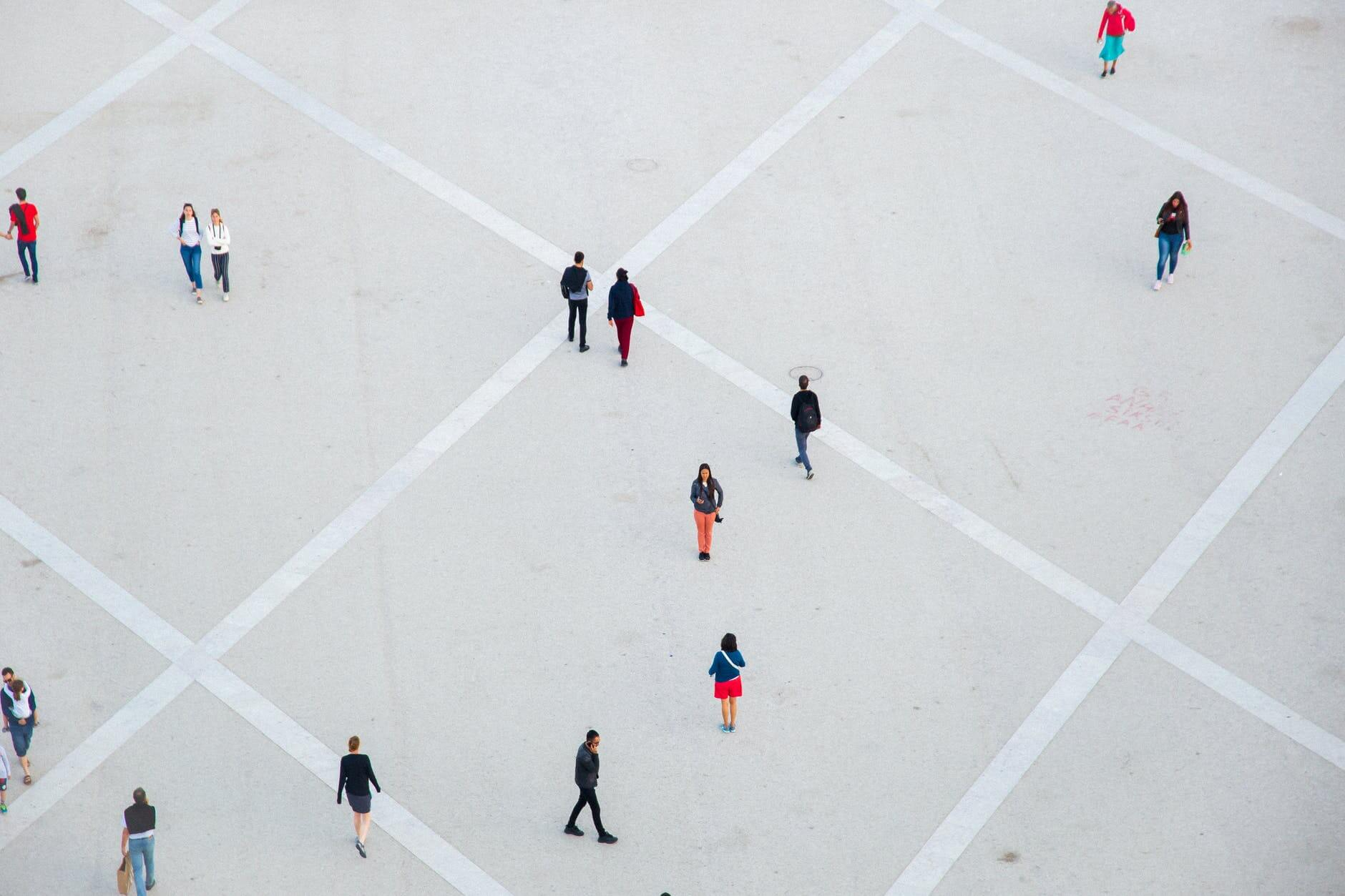 people walking on spacious concrete square