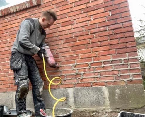 Omfugnig af murværk med mørtel fugepistol