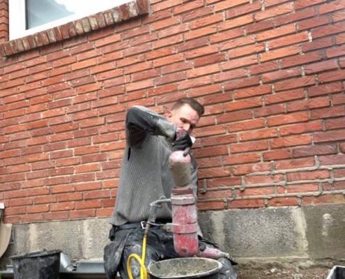 omfugning med fugepistol på lufttryk til mørtel