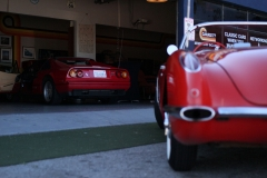 Garage-77-Ferrari-328-Corvette-C1-infront-of-garage