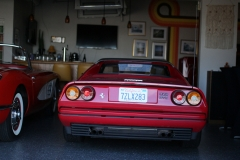 Ferrari-238-Corvette-C1-in-bar-at-Garage-77