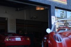 Ferrari-328-Corvette-C1-infront-of-Garage-77