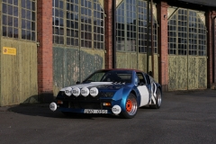 Renault-Alpine-A310-infront-of-a-brick-house