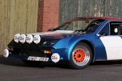 Blue-Renault-Alpine-A310-infront-of-a-brick-house