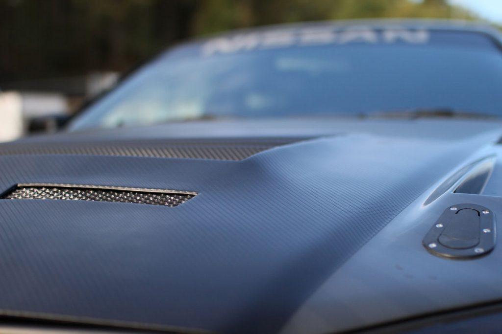 The hood of a Nissan Skyline R34 - 1998
