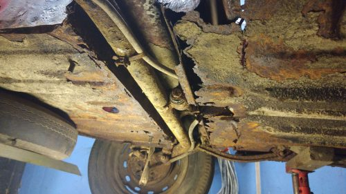 Rusty underneath a saab 96