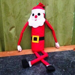 Kerstmanpop met lange benen