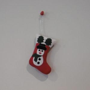 Kerstsok met kruisvormige applicatie