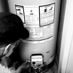 home-improvement-a-plumber-installs-a-new-gas-water-heater-inside-a-home_t20_dxBrRR