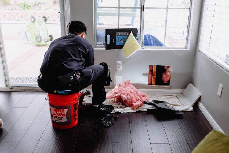 plumber-working-on-a-home-plumbing-leak-issue-home-renovation-repair_t20_Wxmaeg