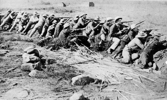 Boer Kommandos taking up positions in a trench