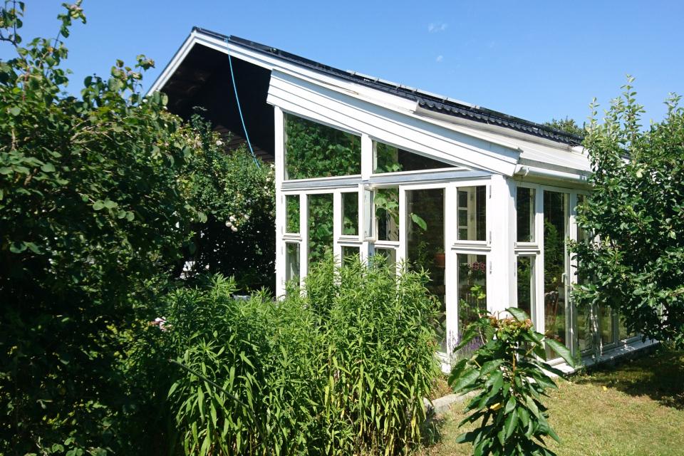 Дом с верандой из вторичного сырья, Дания