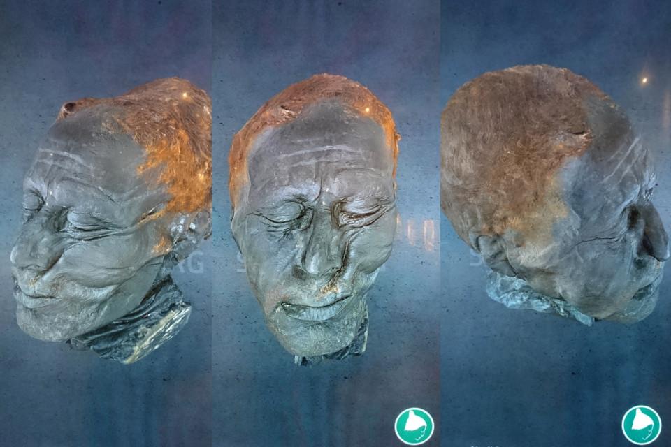 Интерактивная панель с головой человека из Толлунда