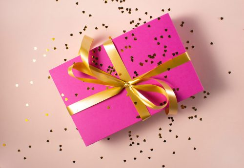 Pink gift box with yellow ribbon