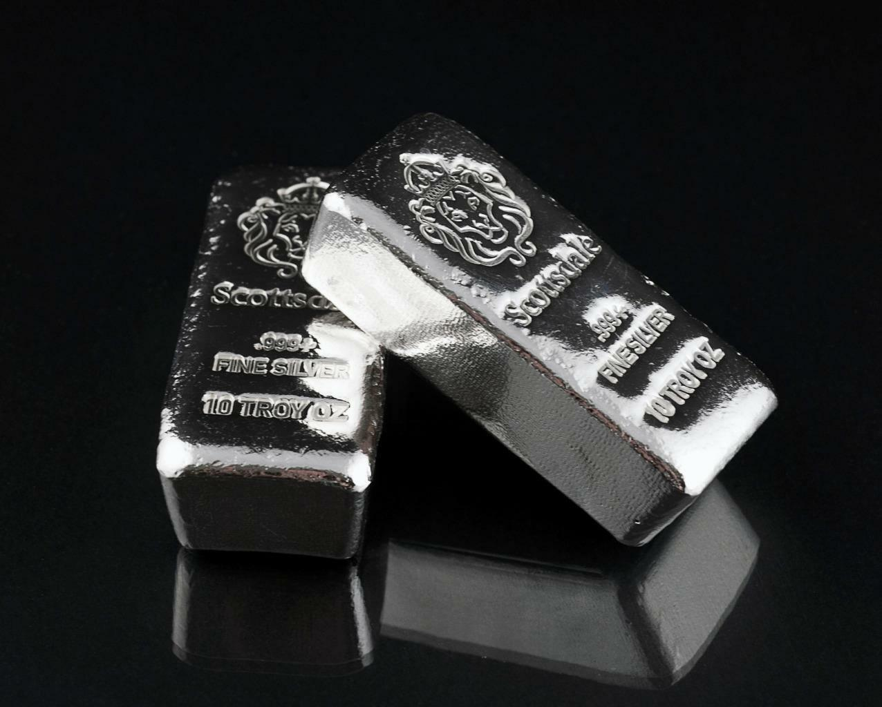 Två stora silver tackor från Scottsdale