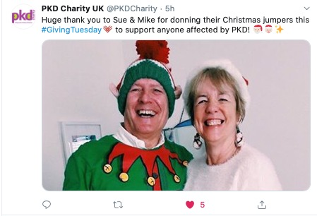 Screengrab of a tweet from PKD Charity saying Huge thanks to Mike and sue for donning their Christmas jumpers this GivingTuesday in support of people with PKD. A photo of a smiling man and woman in ugly Christmas Sweaters is attached