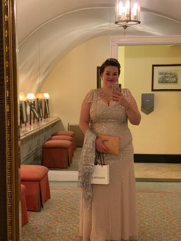 Beate in a sequinned ball gown taking a selfie in the mirror
