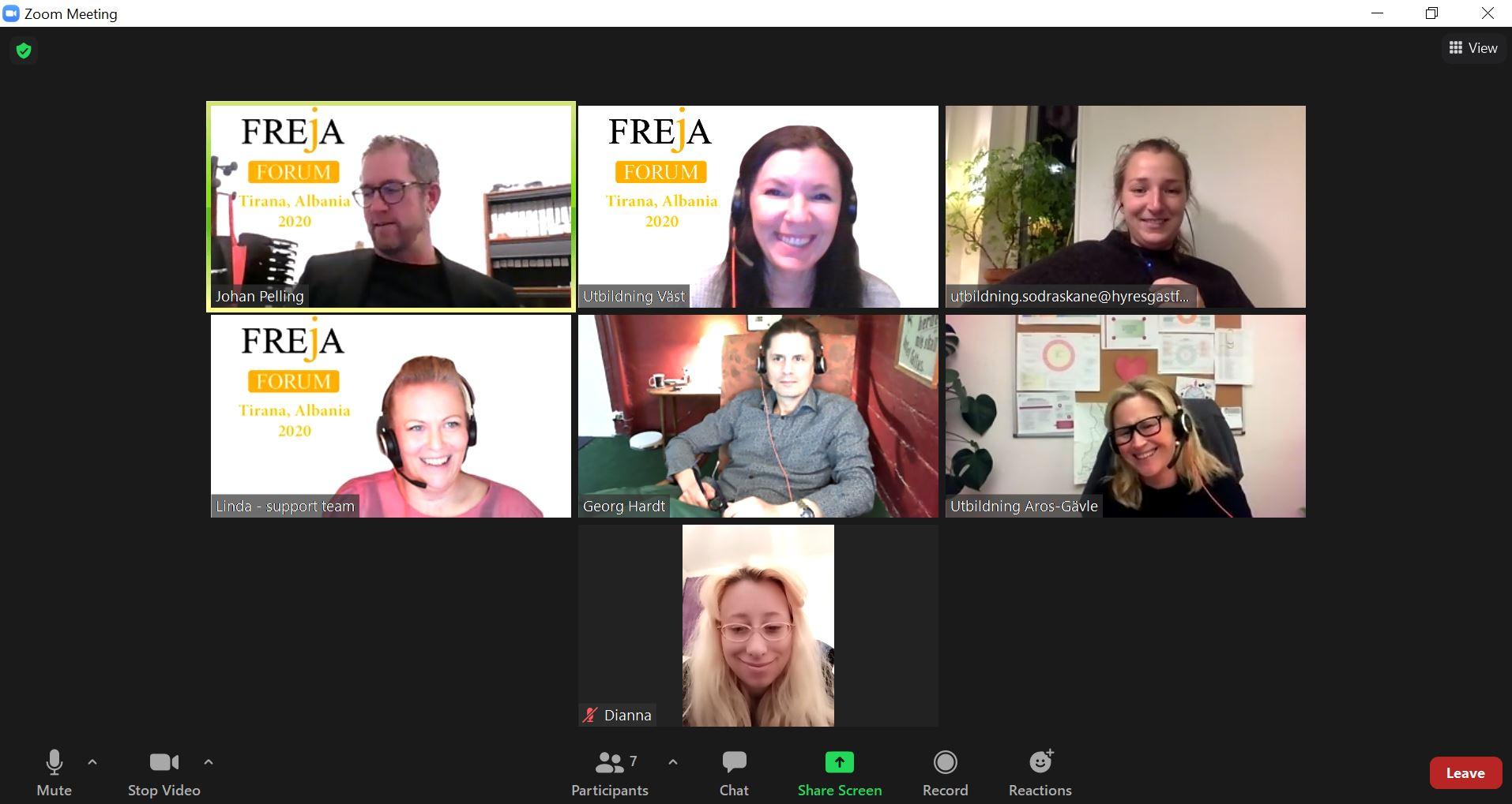 7 people on screen in digital meeting, all laughing, in their homes.
