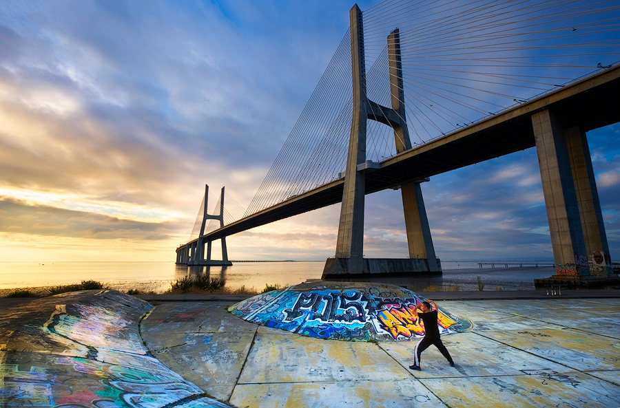 A mand practicing Ti CHi at dawn at Ponte Vasco da Gama, Lisbon. Fuji X-T10 & XF10-24mm