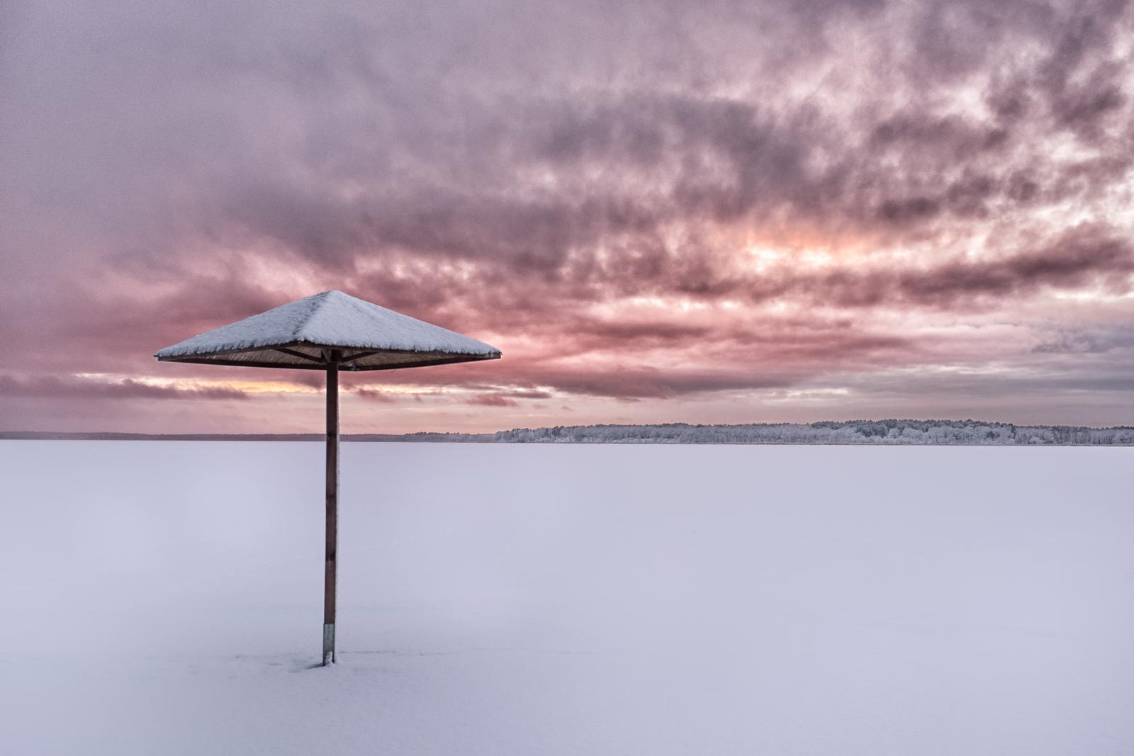 Nowowarpieńskie Sunset –beach and the frozen lake Nowowarpieńskie just after the snowfall on Sunset. Fuji X100s, 1/100s, f8, ISO 200