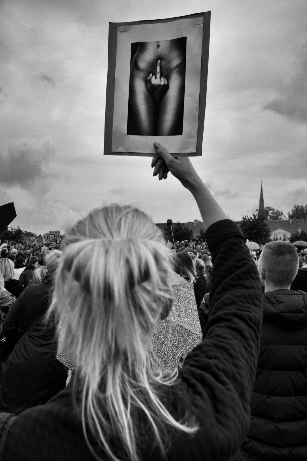 """Black Protest – October 3, 2016, Poland, in the so-called """"Black Monday"""" women took time off work to take to protest against the tightening abortion laws and access to contraception. It's sad and pathetic as the new government in Poland wants to have an impact on everything. The scale of the protest, its form, the number of people gathered spontaneously and their cross exceeded my wildest expectations. Fuji XPro-2, XF 10-20, 1/320s, f5.6, ISO 400"""