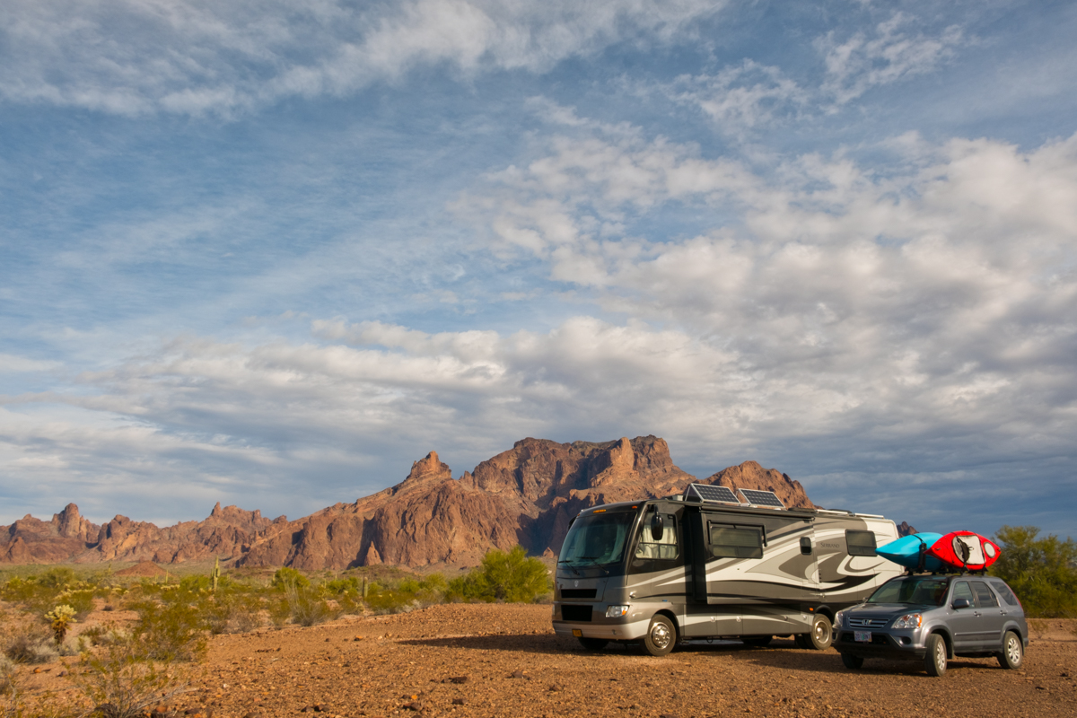 Our RV home on wheels and tow vehicle camping at the KOFA National Wildlife Refuge in southern Arizona.