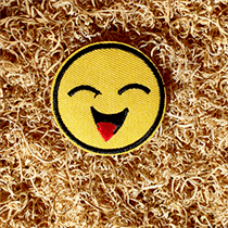 Glimlach badge bij funbadges.nl