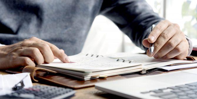 Business Man Hands Schedule Notebook Concept